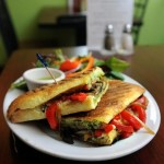 Pictured is Green Leaf's portobello panini - grilled portobello mushrooms, tomato, roasted red pepper, caramelized onions, basil pesto and mozzarella cheese pressed in ciabatta bread. Daily News Staff Photo / Allan Jung
